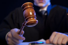 Male judge in a courtroom striking the gavel Stock Photography