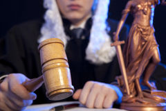 Male judge in a courtroom striking the gavel Stock Photos