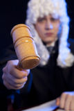 Male judge in a courtroom striking the gavel Stock Image