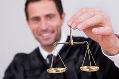 Male Judge Holding Scale Stock Images