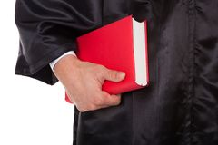 Male judge holding statute book Stock Photography