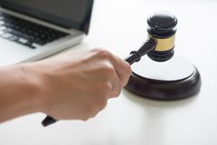 Male Judge lawyer In A Courtroom Striking The Gavel on sounding Royalty Free Stock Images