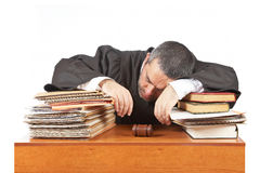 Male judge sleeping over the files Royalty Free Stock Photography