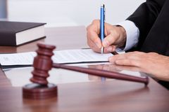Male judge writing on paper Royalty Free Stock Image
