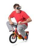 Male jump on a children's bicycle Stock Photography