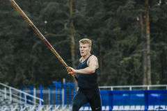 Male jumper prepares to pole vault royalty free stock photo