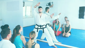 Male karate instructor shows the techniques Royalty Free Stock Photo