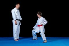 Male karate instructor training little children in dojo.  Royalty Free Stock Images