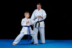Male karate instructor training little children in dojo.  Royalty Free Stock Image