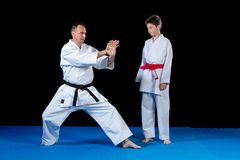 Male karate instructor training little children in dojo.  Royalty Free Stock Photography