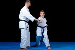 Male karate instructor training little children in dojo.  Stock Photo