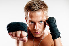 Male kickboxer punshing Royalty Free Stock Photos