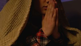 Male kid praying covered with blanket at night, god thanksgiving, trust and hope. Stock footage stock video footage