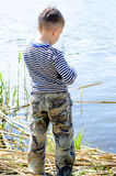Male Kid at the Riverside Preparing for Fishing Royalty Free Stock Photo