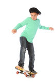 Male kid with a skateboard. Male kid standing on a skateboard royalty free stock photos