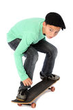Male kid with a skateboard. Male kid standing on a skateboard royalty free stock photo