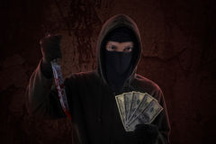 Male Killer Holds Knife And Money Stock Images