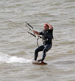 Male kite surfer one handed Royalty Free Stock Images