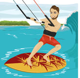 Male kiteboarder enjoys surfing waves with kiteboard Royalty Free Stock Photo