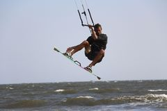 Male kitesurfer boosting big air Royalty Free Stock Photo