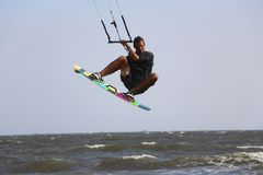 Male kitesurfer boosting big air Royalty Free Stock Image