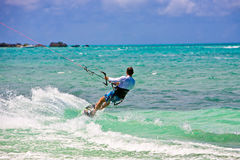 Male Kitesurfer cruising Royalty Free Stock Photography