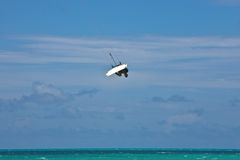 Male Kitesurfer grabing his board Stock Photos