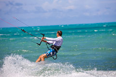Male Kitesurfer turning hard Royalty Free Stock Photos