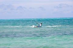 Male Kitesurfer turning hard Royalty Free Stock Image