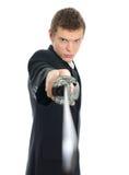 Male kontorsarbetare med svärd. Royaltyfri Foto