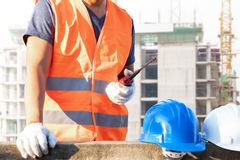 Male laborers are working in the building construction site. Business industry stock images