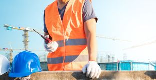 Male laborers are working in the building construction site.  royalty free stock photo
