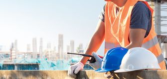 Male laborers are working in the building construction site.  royalty free stock images