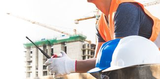 Male laborers are working in the building construction site. Business industry stock photos