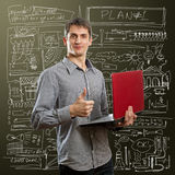 Male with laptop in his hands well done Royalty Free Stock Photos