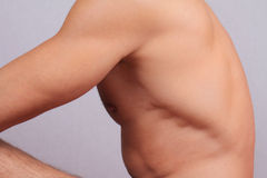 Male laser epilation. Attractive man torso hair removal. Close up on perfect male body, muscles Royalty Free Stock Image