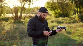 Man launches drone from his hand stock video footage