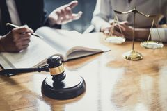 Male lawyer or Counselor working in courtroom have meeting with. Client are consultation with contract papers of real estate, Law and Legal services concept stock image