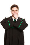 Male lawyer cover mouth with hands. Emotions and communication clear message. Young guy cover mouth with hands. Man wear lawyer suit toga Stock Image
