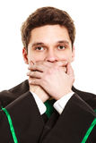 Male lawyer cover mouth with hands. Emotions and communication clear message. Young guy cover mouth with hands. Man wear lawyer suit toga Stock Photo