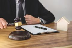 Male lawyer or judge hand`s striking the gavel on sounding block Royalty Free Stock Photos