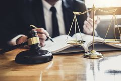 Male lawyer or judge working with contract papers, Law books and. Wooden gavel on table in courtroom, Justice lawyers at law firm, Law and Legal services stock photo