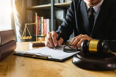 Male lawyer in the office with brass scale stock photography