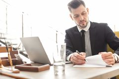 Male lawyer in office. Male lawyer working in office royalty free stock photos