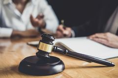 Free Male Lawyer Or Counselor Working In Courtroom Have Meeting With Client Are Consultation With Contract Papers Of Real Estate, Law Stock Photo - 136979640