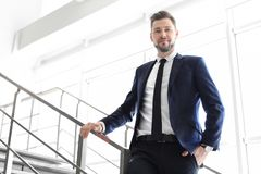 Male lawyer standing near stairs. In office Stock Image