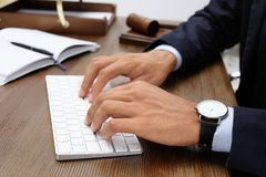 Male lawyer working with computer at table. Closeup Royalty Free Stock Photos