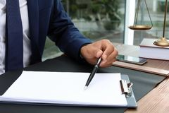 Male lawyer working with documents at table royalty free stock images