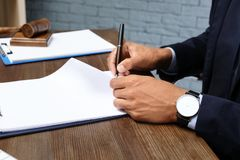 Male lawyer working with documents at table. In office, closeup royalty free stock image