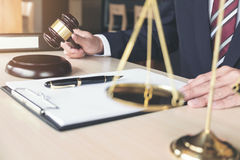 Male lawyer working with gavel and scales of justice, note paper Royalty Free Stock Photography